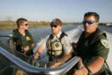 Bayou Sauvage Refuge officers working with Louisiana Wildlife officers.