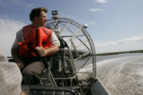 Airboat pilot at work on refuge
