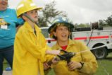 Child learns about refuge fire management