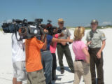 Wildlife Biologist Jackie Isaacs is interviewed by various news groups