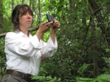 Service botanist Carolyn Wells takes a compass bearing