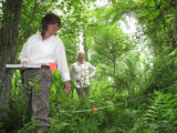 Service botanist Carolyn Wells and Atlanta Botanical Garden's Jenny Cruse-Sanders looking for...