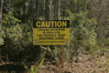 "Sign: ""Caution: Logging Operation in Progress"""