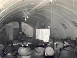 Meeting in Quonset hut