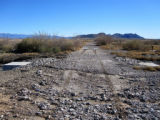 Road damaged by debris due to flooding in the Ash Meadows National Wildlife Refuge