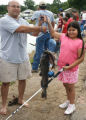 Father and daughter hold fish