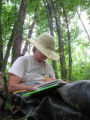 NC Wildlife Resources Commission bio tech Dottie Brown takes a break from searching for bog...