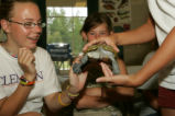 Young girls learn about turtles