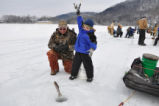 Young boy enjoys ice fishing