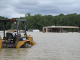 Mississippi: Rabbit on backhoe with shop flooded