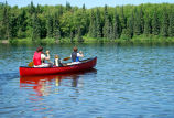People in canoe on lake