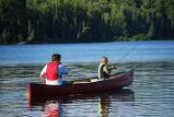 Fishing from canoe on lake