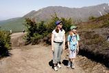 Woman and girl hike on Flattop Mountain