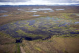 Aerial view of mountains and wetlands