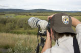U.S. Fish and Wildlife Service employee taking photograph at Tetlin Natinal Wildlife Refuge