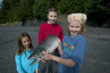 Children holding a fish at Kodiak National Wildlife Refuge