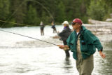 Adults fly fishing
