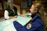 Volunteer shares a map with a refuge visitor