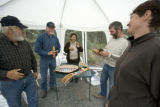 Visitors examining crafts provided by the U.S. Fish and Wildlife Service employee