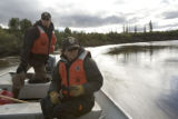 U.S. Fish and Wildlife Service personnel navigating a boat in Alaska