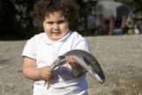 Small girl holding a fish