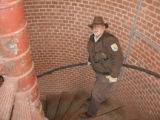 Service employee on the cast-iron spiral staircase inside the Assateague Lighthouse