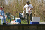 Man showing his catch at Lacassine National Wildlife Refuge