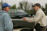Service employee talking to a visitor at Lacassine National Wildlife Refuge