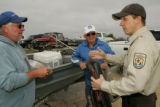 Service employee talking with fishermen at Lacassine National Wildlife Refuge
