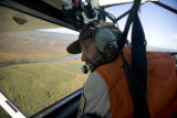 U.S. Fish and Wildlife Service pilot flies over the refuge