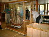 Service employees setting-up the Spanish Galleon exhibit
