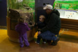 Family learning about an underwater exhibit at the Herbert H. Bateman Educational and...