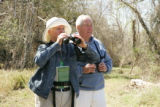 Two adults wildlife watching