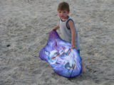 Little boy holding his boogie board