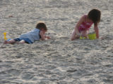 Two children playing in the sand