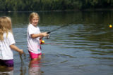 Girls fishing in knee deep water