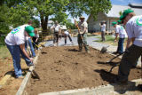 Group of Youth Conservation Corps gardening at the Outdoor Nature Explore Classroom