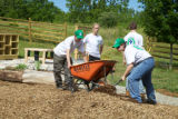 Youth Conservation Corps volunteers spreading mulch