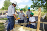 Youth working together to build a bridge