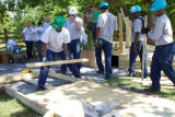 Volunteers building a footbridge
