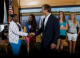 Student shakes the hand of Robert F. Kennedy, Jr.