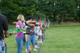 Students learning archery skills