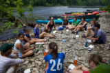 Student Climate and Conservation Congress youth relax on the shore of the Potomac River