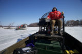Service employee pilots airboat
