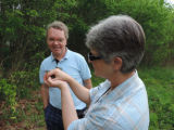 Service employees preparing to release Red-eyed Vireo