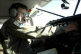 Service pilot controls the aircraft