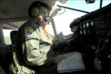 Service pilot reviewing map before takeoff
