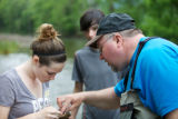 Service employee assists with macroinvertebrate identification