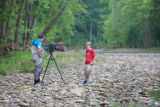 Service employee interviews student during outdoor education event