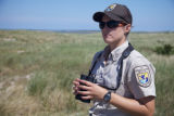 Staff with binoculars at Monomoy NWR